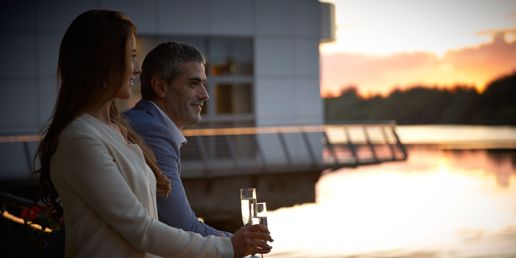 couple-champagne-balcony-Clayton-Hotel-Limerick-River-Shannon