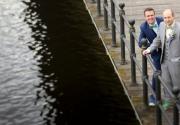 couple-on-the-broadwalk-outside-Clayton-Hotel-Limerick-on-their-wedding-day-1130x505_c