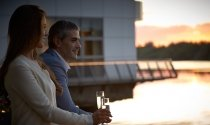 couple-champagne-balcony-Clayton-Hotel-Limerick-River-Shannon
